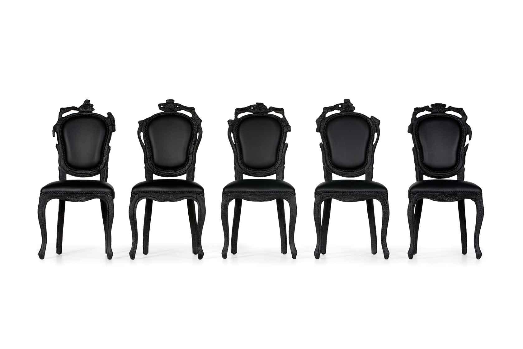 Fünf schwarze, gepolsterte Stühle von Moooi in einer Reihe